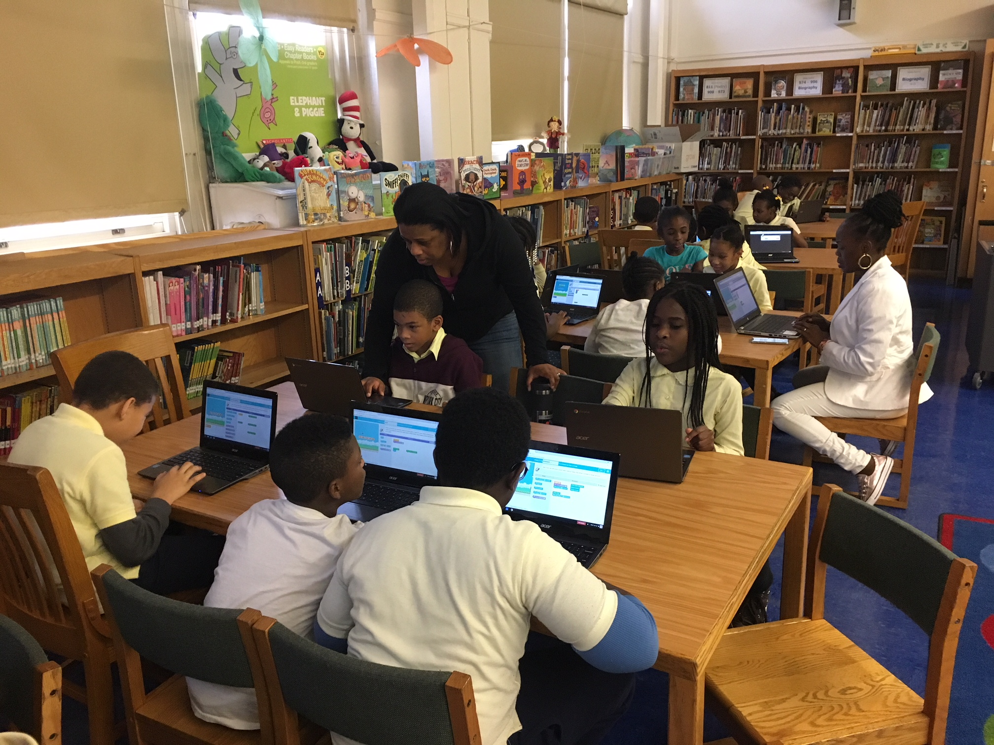 Ms. Spellman and students code a Flappy Game in the library