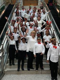 Ms Grechko with chorus pose on escalator at Kings Plaza mall