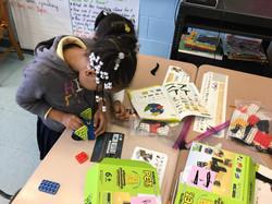 First grader building with Robotis kit