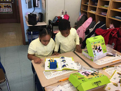 First graders building with Robotis kits