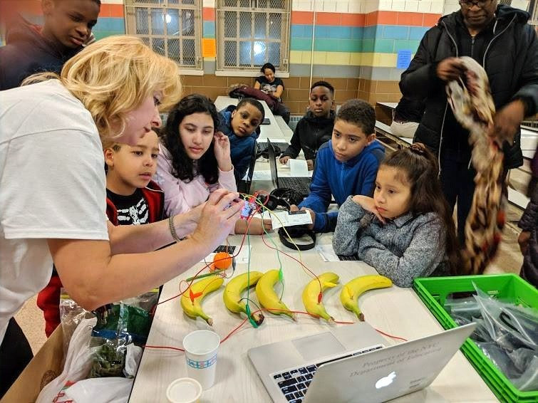 Ms. Grechko helps students make music using fruit and Makey Makey