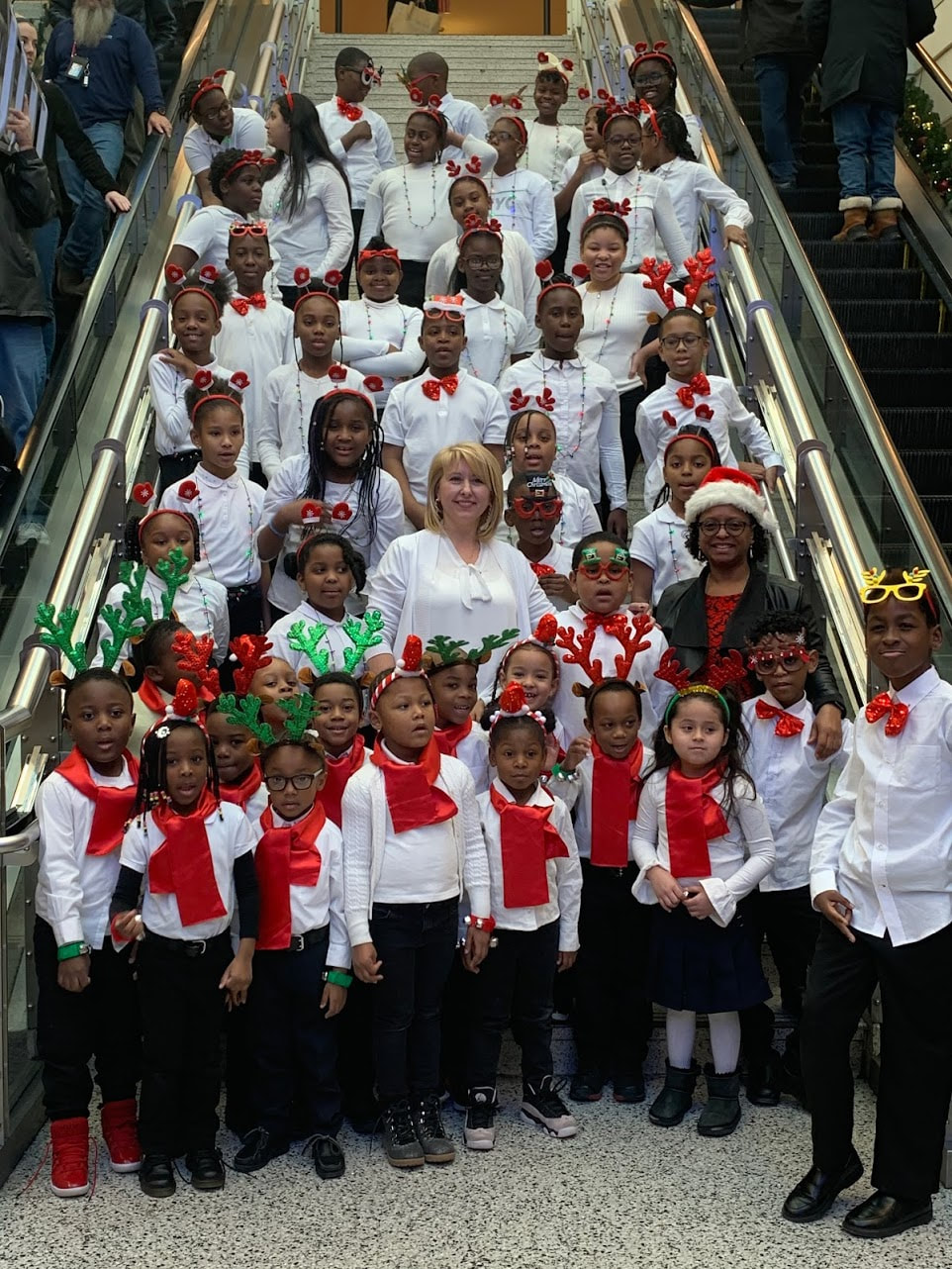 Ms. Grechko and Ms. Garcia with chorus at Kings Plaza