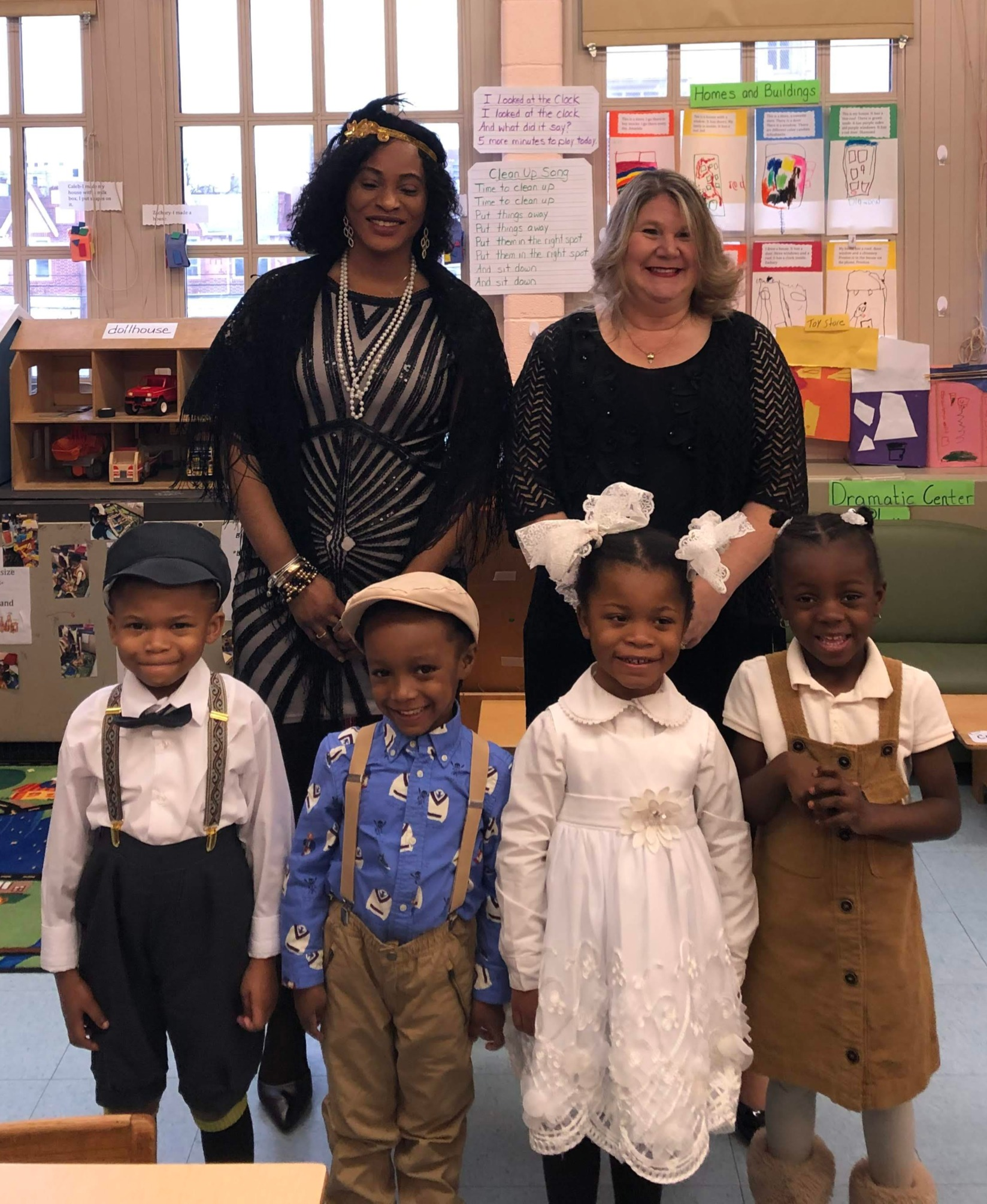 Ms. Williams and Ms. Davis with students in costumes