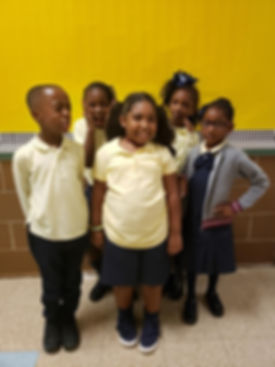 5 students pose in their uniforms