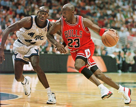 Michael Jordan dribbles ball in game