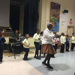 Singer teaches students a new dance