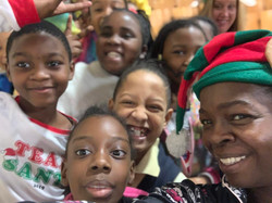Ms. Browne in elf hat with students.jpg