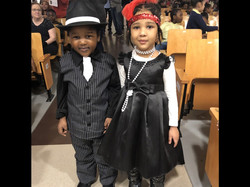 Caiden and Lenile in fancy 20's era clothing