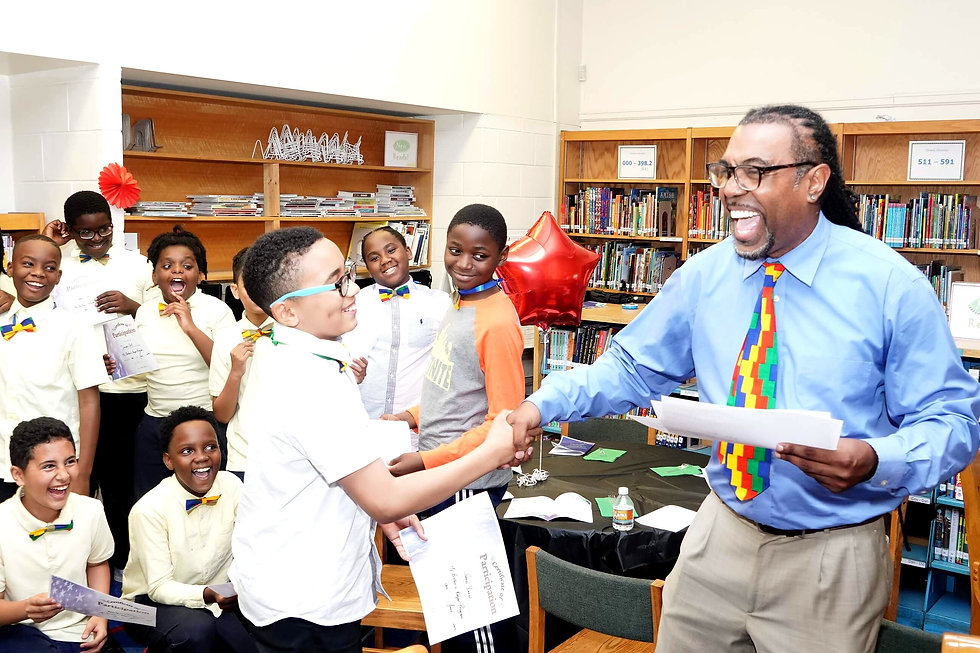 Mr. Bourne celebrates with his My Brother's Keeper Club