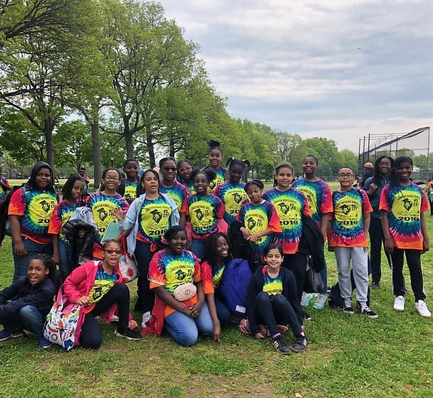 Group of graduating 5th graders in PS 233 class of 2019 tie-dyed tee shirts
