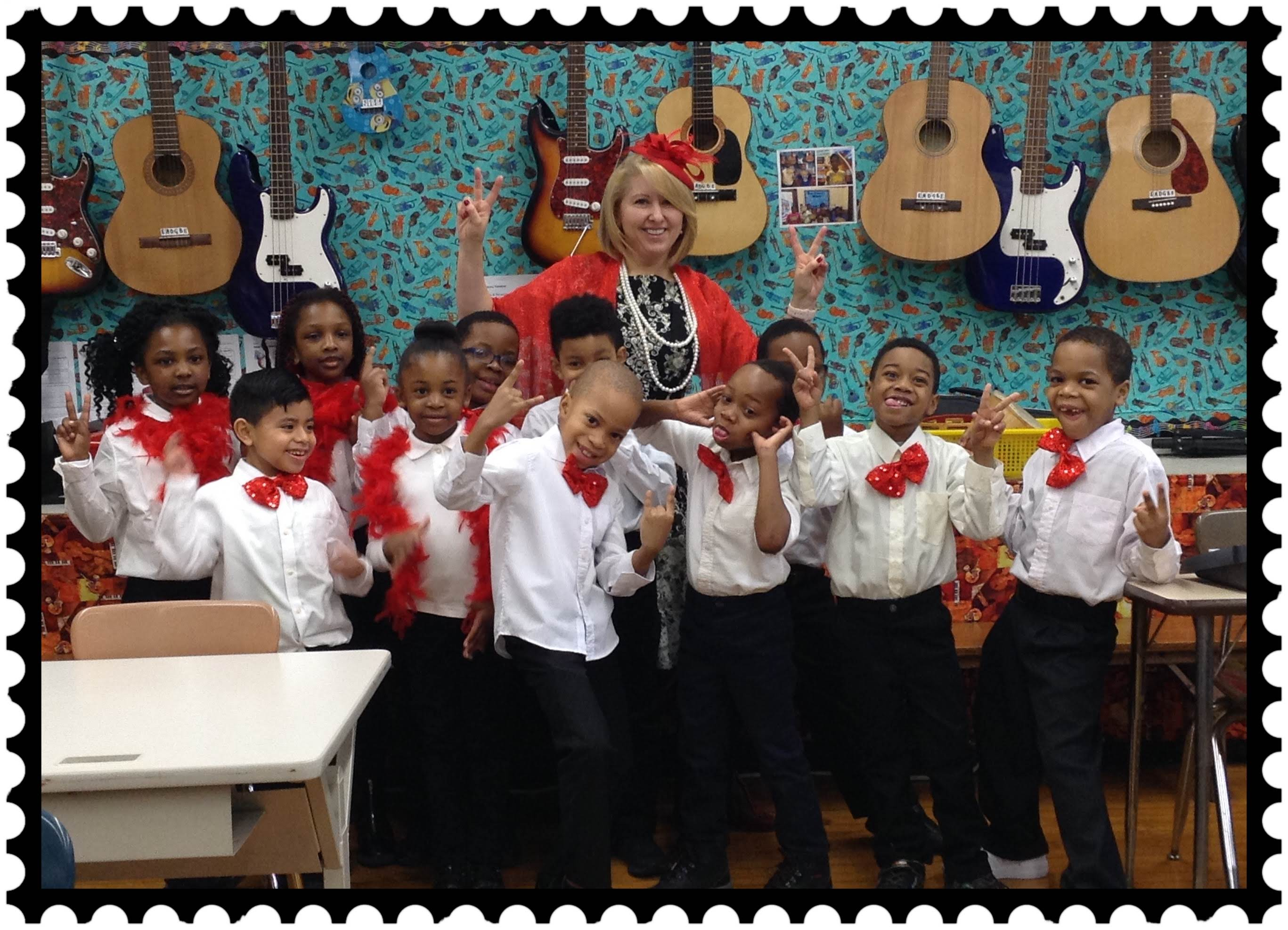 Ms. Grechko and students in red and white