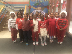 second graders dressed in red and white