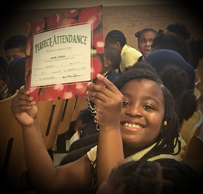 Chelsea holds up her perfect attendance