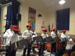 Students perform on steel drums