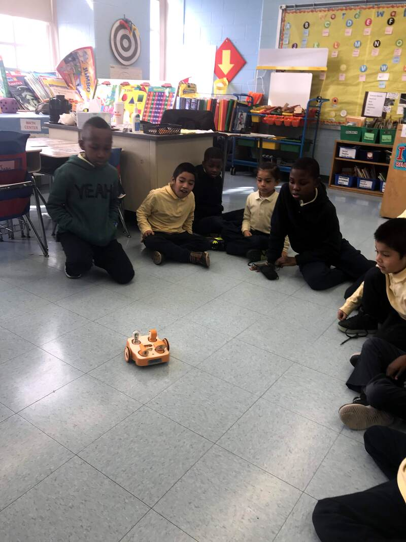 Ms. Schulman's students gather to program a Kibo robot