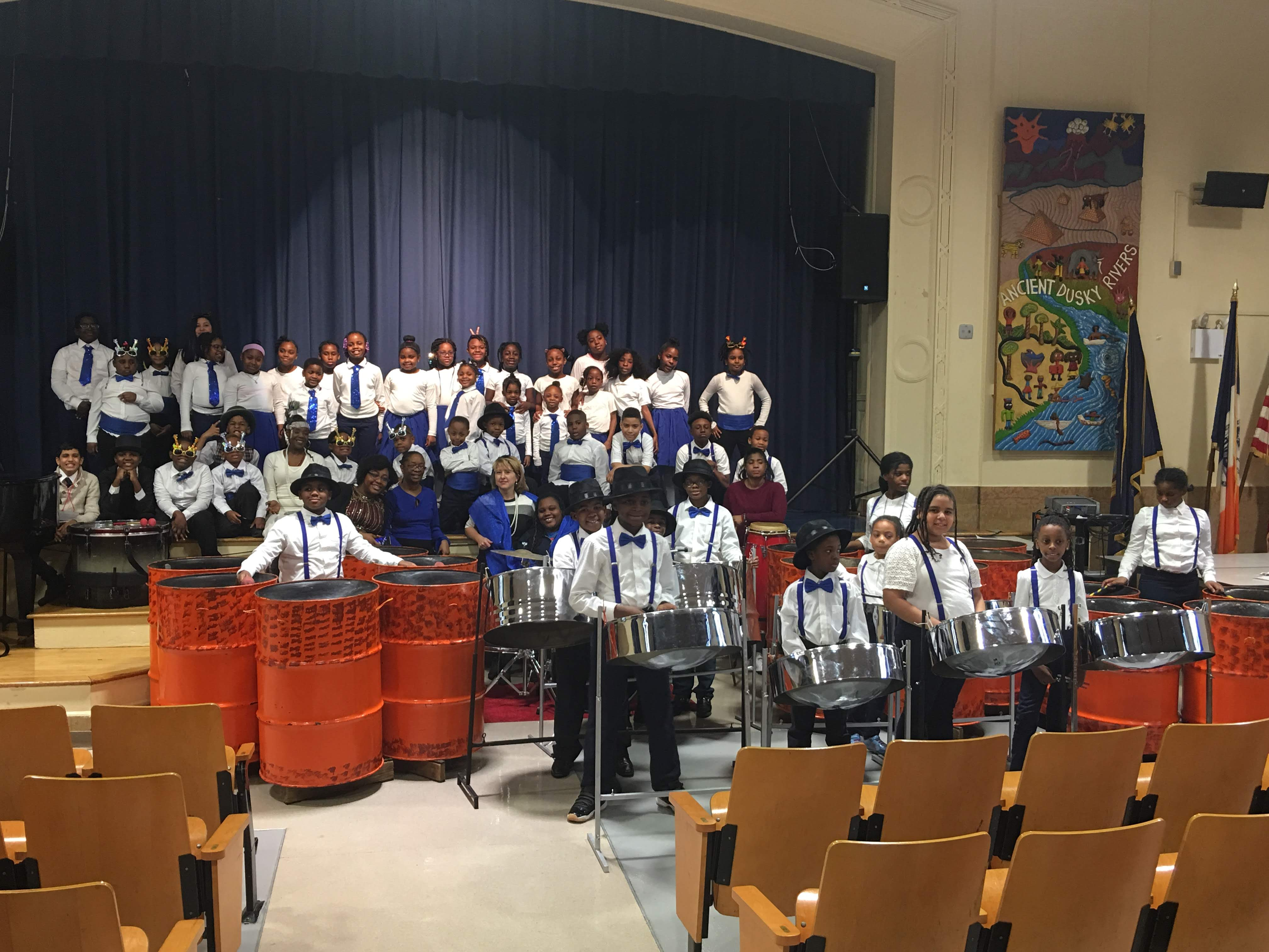 Chorus and steel drum students pose together