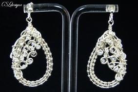 Organic teardrop wirework earrings both.