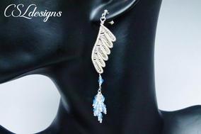 Wirework wings earrings face.jpg
