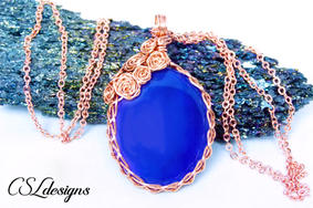 Rose covered wire wrapped cabochon purpl