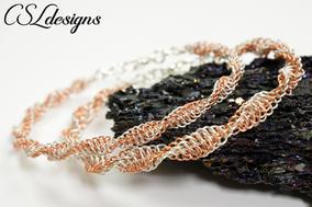 Two colour spiral wire macrame bracelet.