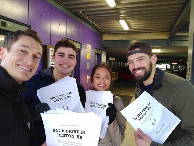 Promoting the sock drives by handing out fliers!