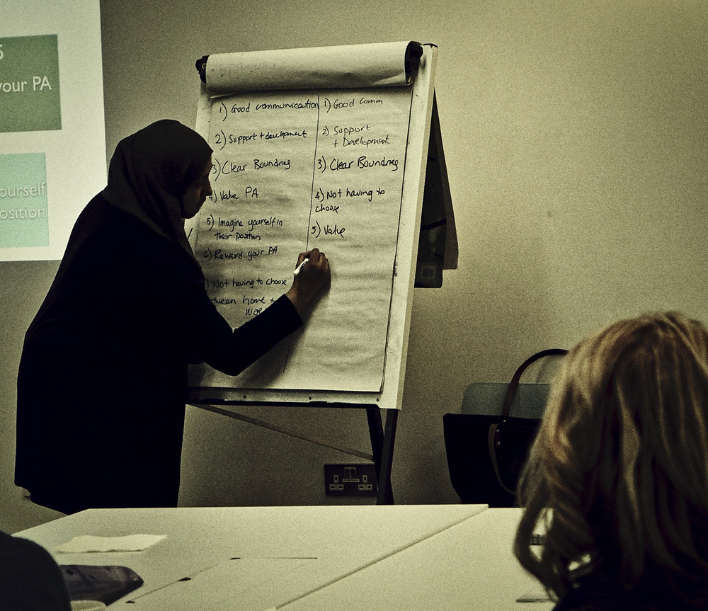 Woman writing on a flip chart during a training session