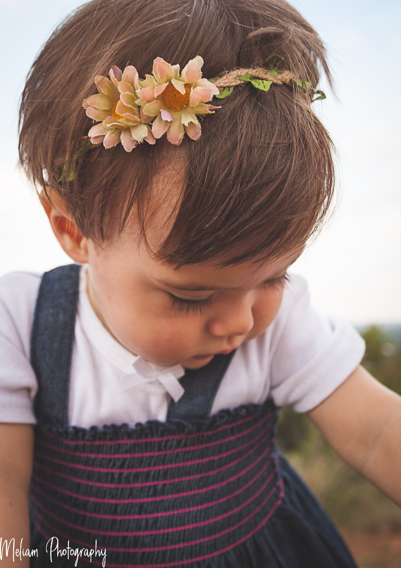 With flowers in her hair