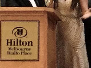 Receiving an achievement Award in Melbourne Florida .