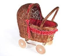 Rieten poppenwagen met rode franje