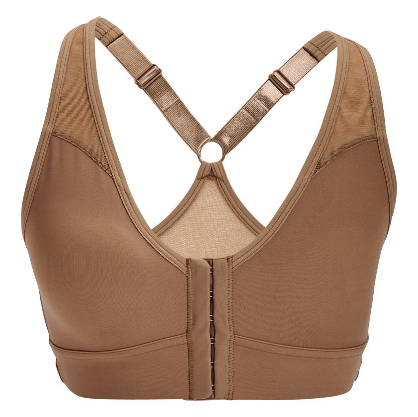 Product image of the Bianca Sports Bra in Nude. It has hook-and-eye closures down the front, cross cross straps in the back and a mesh back