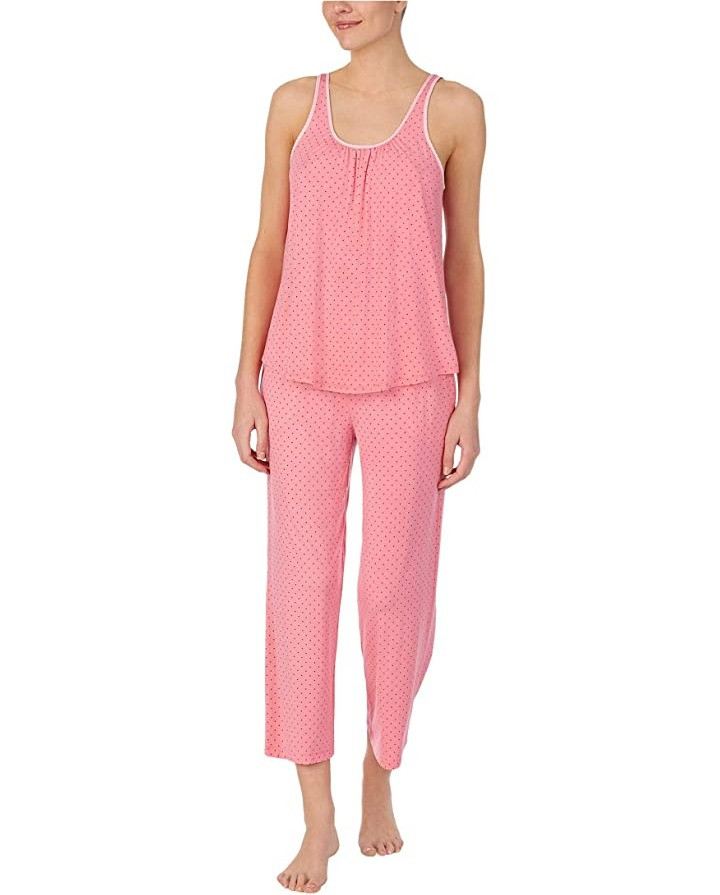 Pink with polka dot design pajama tank and pants. Tank has white detail around neckline and sleeve holes.