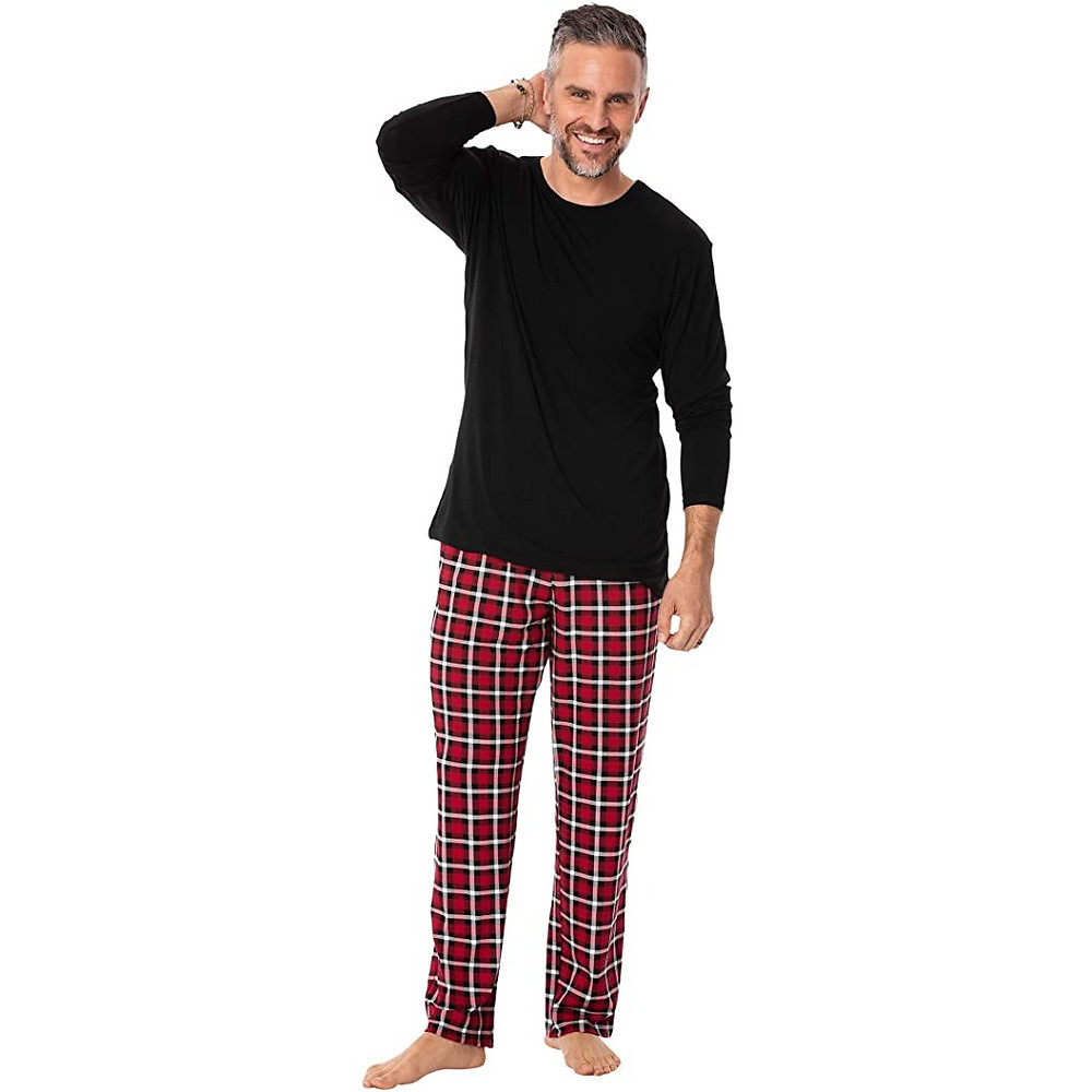 Black love sleeve pajama top and red, black, and white plaid pants.