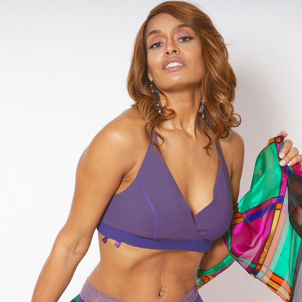 Purple criss-cross, plunge bra. Wraps around using Velcro and magnets.