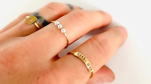 Yang Orbitz Gold Fidget Ring with three moving silver beads