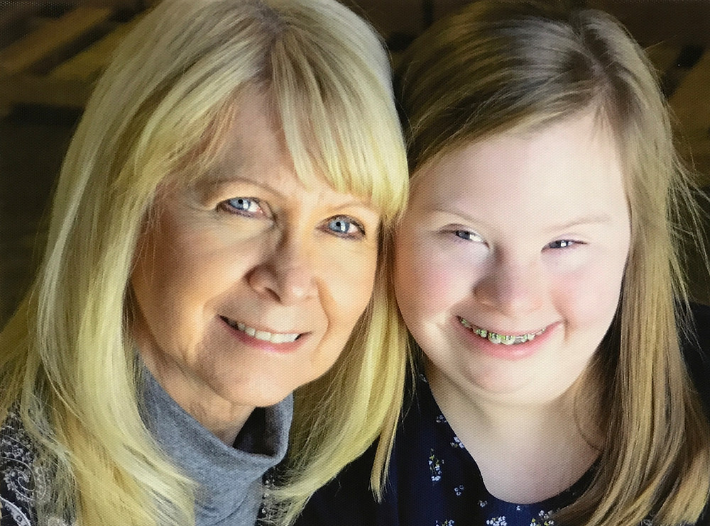 Photo of Karen Bowersox with her granddaughter Maggie. They are both smiling and  looking directly in the camera.