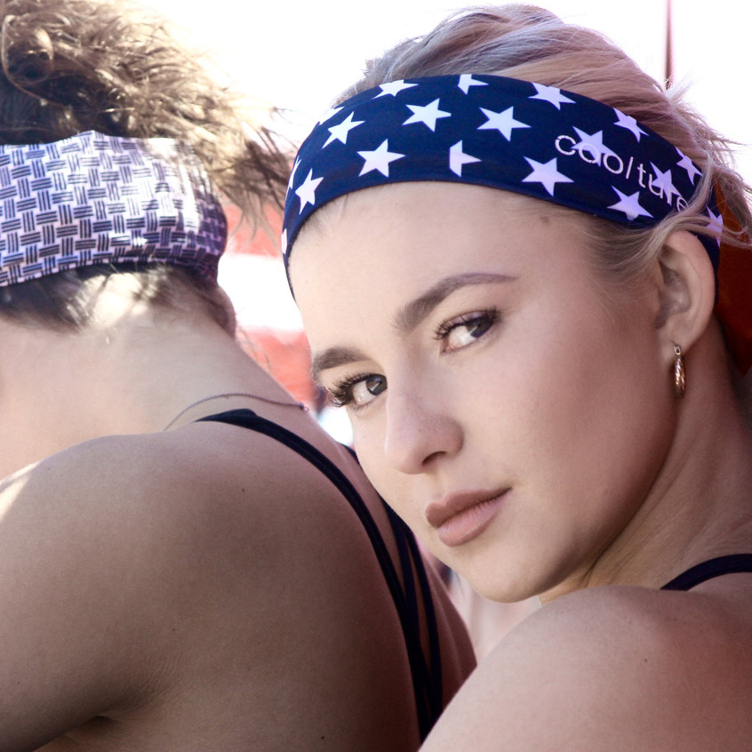 Beautiful female model looking right at camera wearing our USA Cooling Headband