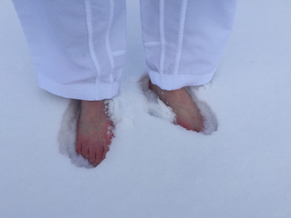 Frosty feet and cold kicks: Annual taekwondo club tradition doesn't back down for Old Man Winter