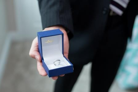 The brides ring, held by the groom