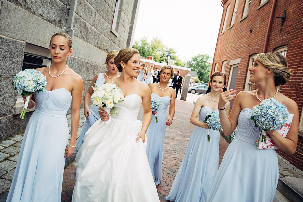 A bride and her bridal party making their way to the ceremony