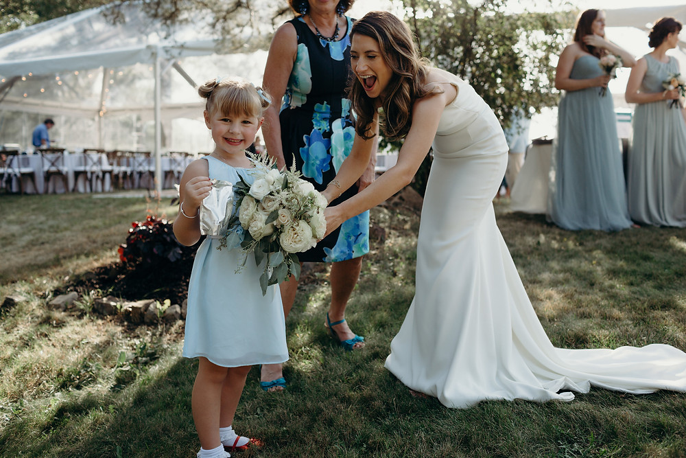 A bride with one of her littlest guests