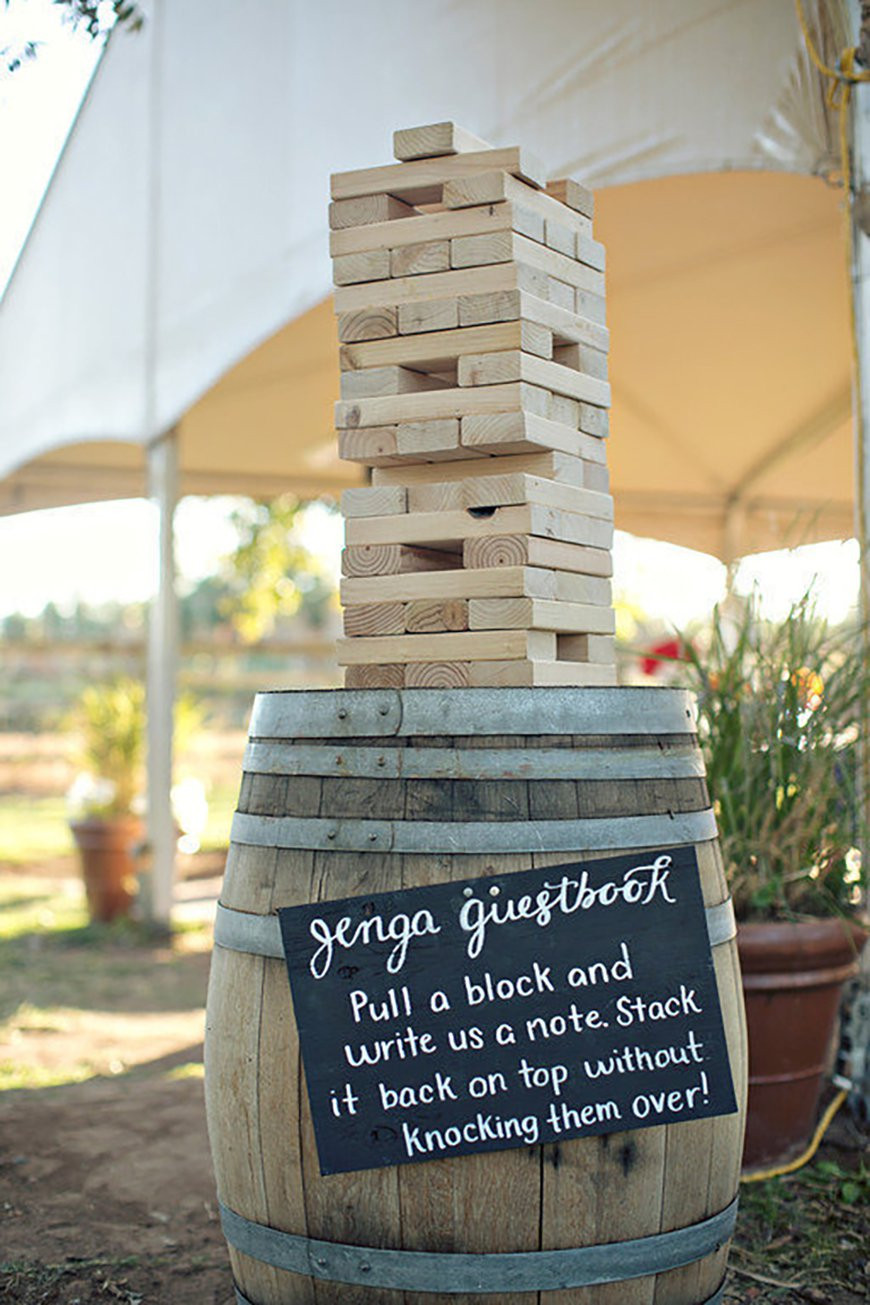 Jenga being used as a guest book and a game for guests