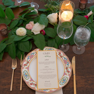 table setting with plates and menu