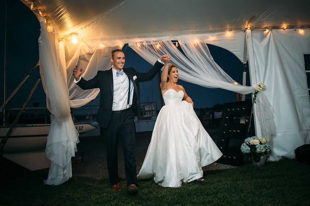 just married couple entering tenting reception