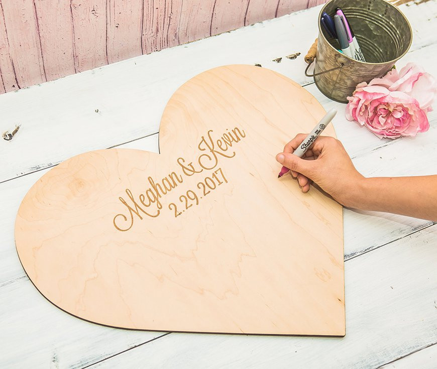 A personalized wooden heart shaped guest book