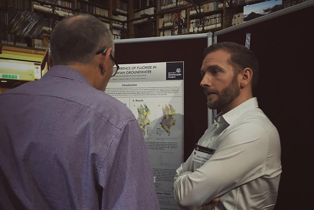 Marc discussing his research during the poster session