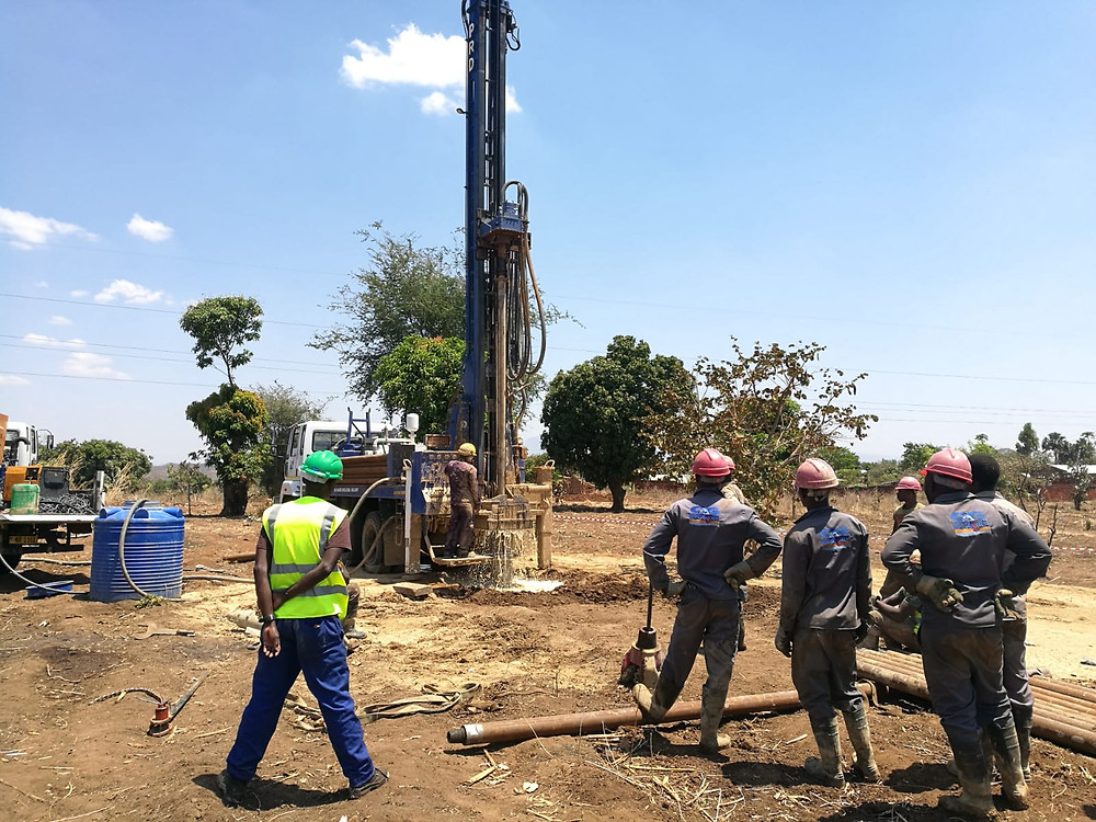 The drilling crew during the process