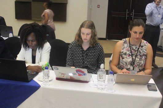 Figure 2: Christina (centre) taking notes at the meeting next to the Malawi representative, Zione Uka (left) and Stephanie Hawkins (right)