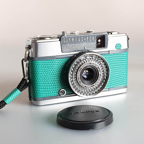 Olympus PEN EE-2 35mm Half-Frame compact camera In green Lizard effect covering.