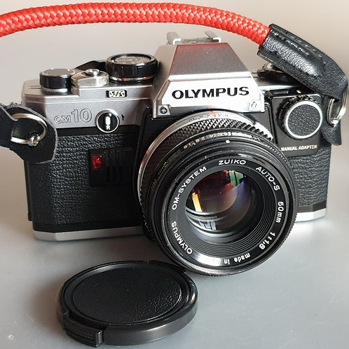 Olympus OM10 with Zuiko  MC 50mm 1.8 MD lens.