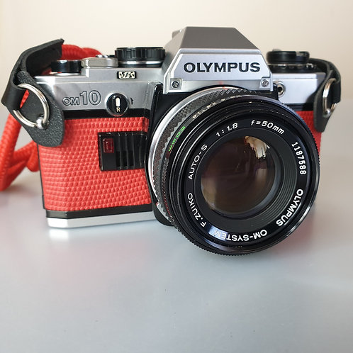 Olympus OM10 with F-Zuiko  Auto-S 50mm 1.8 lens. Reskinned in red leather
